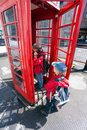 Boy talking in pay phone box Royalty Free Stock Photos