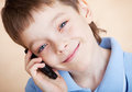 Boy, talking on the phone Stock Images