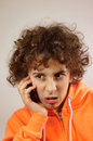 A boy is talking on the phone Royalty Free Stock Photo