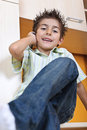Boy talking to mobile phone Royalty Free Stock Images