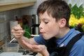 Boy Tasting Noodles