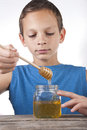 Boy tasting some honey Stock Image