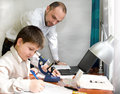 Boy with teacher in the laboratory Royalty Free Stock Images