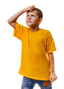 Boy teen blonde in yellow shirt child scratching his head looking up thinking Stock Photography