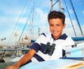 Boy teen sailor laying on marina boat chart map Stock Images