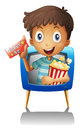 A boy on the television holding a ticket and a popcorn illustration of white background Royalty Free Stock Image