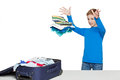 Boy throwing many clothes to luggage bag Royalty Free Stock Photo