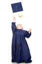 Boy throwing mortarboard Royalty Free Stock Photos