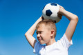 Boy throws a ball for football Royalty Free Stock Photo