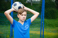 Boy throws a ball out on the field Stock Photos