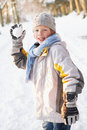Boy About To Throw Snowball In Snowy Woodland Royalty Free Stock Photography