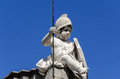 Boy on top of building statue a in spain Royalty Free Stock Image