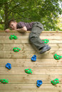 Boy on top of a climbing wall Royalty Free Stock Photo