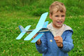 Boy with toy airplane in hands Stock Photos