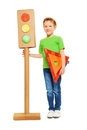 Boy with traffic light model and warning triangle Royalty Free Stock Photo
