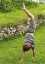 Boy training handstand Royalty Free Stock Photo