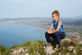 Boy traveler on top of a mountain resting at the foot the town Royalty Free Stock Photos