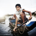 Boy Traveling by Boat in Floating Village Concept Royalty Free Stock Photo