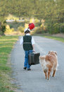 Boy Traveling with Dog Royalty Free Stock Photo