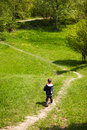 Boy on trekking path walking Royalty Free Stock Photo