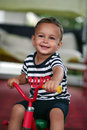 Boy on a tricycle Stock Image