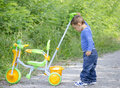 Boy with tricycle little playing in park Stock Photo