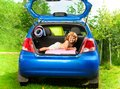 Boy in the trunk with baggage cute little laying on back of bags and car ready to go on vacation Stock Image