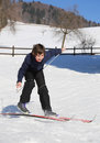 Boy trying the cross country skiing inexperienced and then falls on snow Stock Photo
