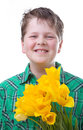 Boy with tulips yellow isolated on white Stock Photography