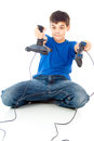 Boy with two joysticks plays video games Stock Photography