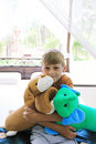 Boy with two stuffed toys Royalty Free Stock Image
