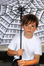 Boy with umbrella Royalty Free Stock Images