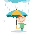 Boy with umbrella standing under the rain.