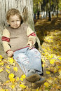 Boy under the autumn tree Stock Photography