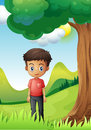 A boy under the shade of a big tree illustration Stock Images
