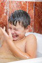 Boy under shower Royalty Free Stock Photo