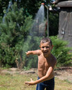 Boy under a shower Royalty Free Stock Photo