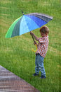 Boy under umbrella Royalty Free Stock Photo