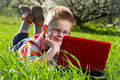 Boy using his laptop outdoor in park Royalty Free Stock Photos