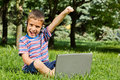 Boy using his laptop outdoor in park Stock Image