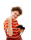 Boy using video game controller Stock Images
