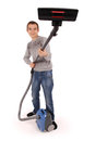 Boy with vacuum cleaner isolated on white background Stock Photo