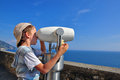 Boy at the viewpoint looking in binocular over sea in liguria italy Stock Photo