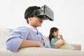 Boy in virtual goggles amazed sitting on the sofa Stock Photography