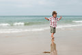 A boy waiting ride on a beach photo of walking who is his turn to Stock Image