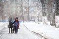 Boy walking with a big dog in winter park Royalty Free Stock Photo