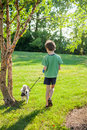 Boy walking dog Royalty Free Stock Photo