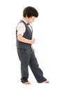 Boy walking imaginary line little in a suit and bare feet an against a white background Stock Images
