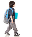 Boy walking to school Royalty Free Stock Image
