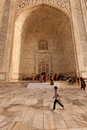 Boy walks past tomb portico at the Taj Mahal Stock Photos